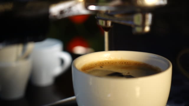 espresso shot pouring out. - espresso maker stock videos and b-roll footage