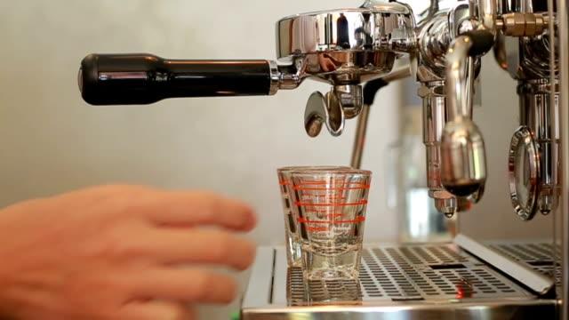 2 espresso shots getting brewed into shot glasses