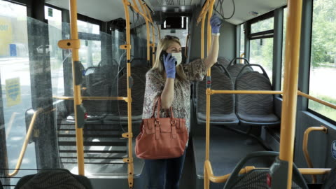 essential worker in public transportation, talking on the phone - public transport stock videos & royalty-free footage