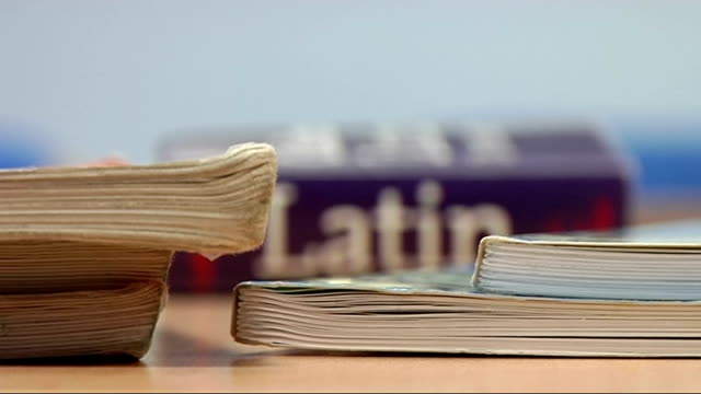 barking barking abbey school int latin textbook on desk in classroom close up of pages of latin book - textbook stock videos & royalty-free footage