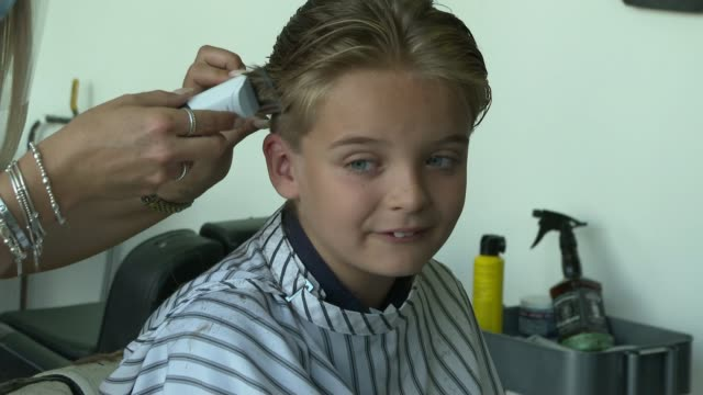 essex boy has hair cut for first time in nine years; england: essex: ext reilly stancombe playing football reilly stancombe and sister showing long... - boys stock videos & royalty-free footage