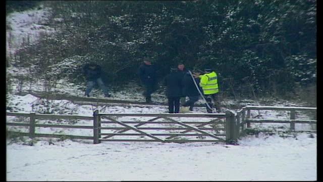 convicted men appeal; tx 7.12.2005 police search snow-cevered field near crime scene/ farm near crime scene - murder stock videos & royalty-free footage