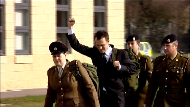 essex colchester ext lance corporal joe glenton flanked by military guard as along with raised fist to military police van - fist stock videos & royalty-free footage
