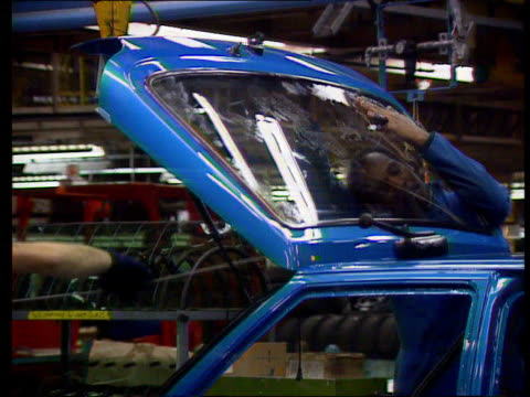 dagenham ford fiesta cars being produced on production line - dagenham stock videos & royalty-free footage