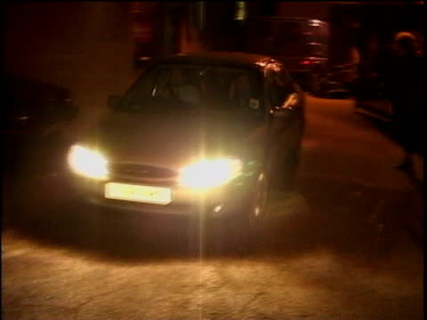 stockvideo's en b-roll-footage met essex: harlow: ext / night car towards & past containing television presenter michael barrymore - channel 4 news