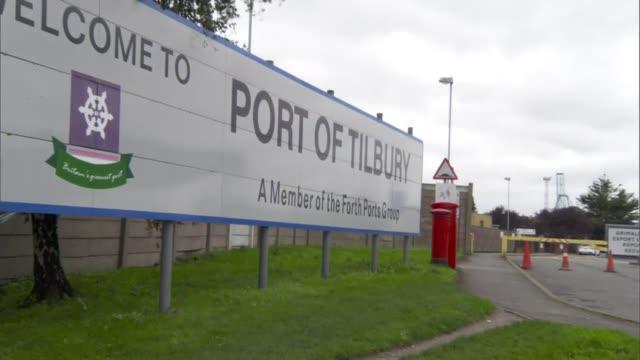 general views of tilbury docks; england: essex: tilbury docks: ext police tape at the entrance to the port of tilbury with port entrance sign behind... - エセックス州点の映像素材/bロール