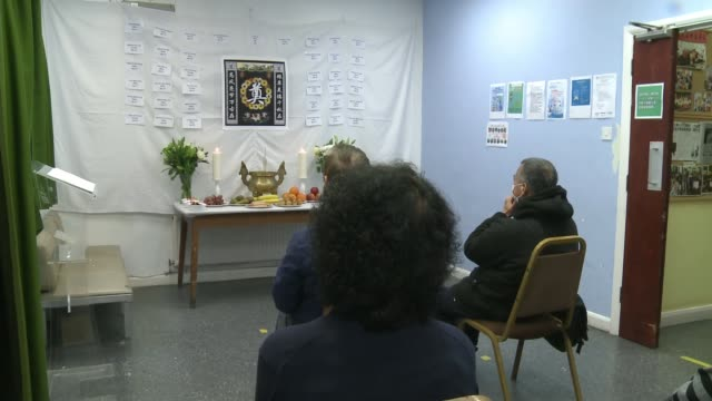 hackney group mark first anniversary with memorial shrine; england: london: hackney: hackney chinese community services: int various of people seated... - shrine stock videos & royalty-free footage