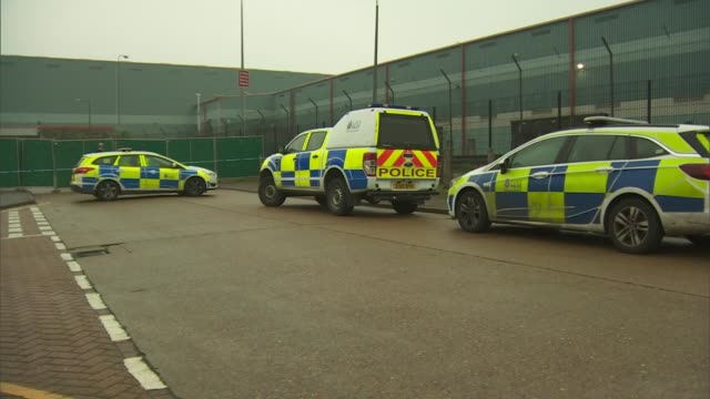 lorry trailer arrives in purfleet in essex with police officers and cars in attendance england essex thurrock purfleet ext various shots of police... - thurrock stock videos and b-roll footage