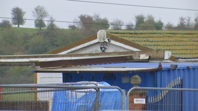 trial hears of previous people smuggling report england essex ext weather vane attached to post farm buildings - itv london tonight stock videos & royalty-free footage