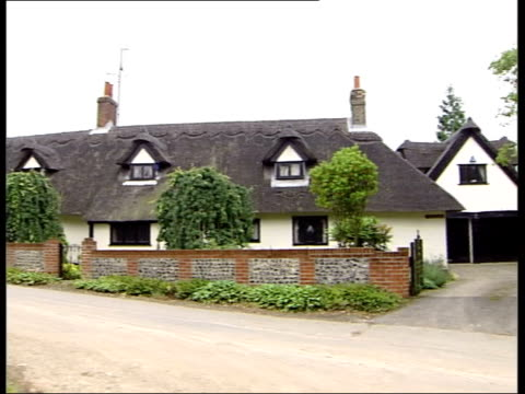 essex nr saffron walden gv house pan ms window in thatched roof ms house - strohdach stock-videos und b-roll-filmmaterial