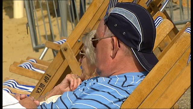 essex southend ext middleaged british man seated in deckchair on beach - deckchair stock videos & royalty-free footage
