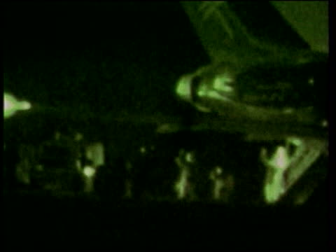 Essex Stansted Airport EXT/NIGHT GREEN NIGHTSCOPE PIX Hijackers along from plane as giving up LS Police arresting hijackers
