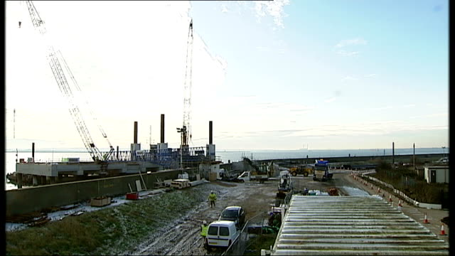 essex thurrock ext general view port area cranes and estuary construction digger along offshore crane and fuelling point - thurrock stock videos and b-roll footage