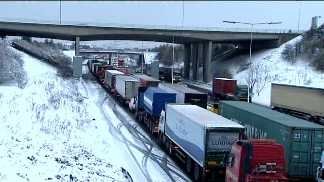 essex thurrock trucks/lorries queued up in traffic gridlock on m25 motorway motorway traffic police officer directing gridlocked traffic - thurrock stock videos and b-roll footage