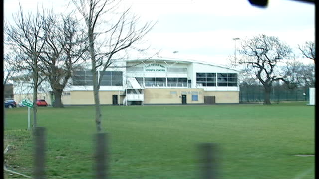 waltham forest: traffic along main road sports ground pavilion and football pitches bob mansfield interview sot - achilles tendon stock videos & royalty-free footage