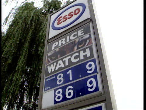 esso price watch *sound as incoming* london esso price watch sign showing price of fuel 'unleaded 819 p / lrp**** 969p / diesel 859p / cars into... - unleaded stock videos and b-roll footage