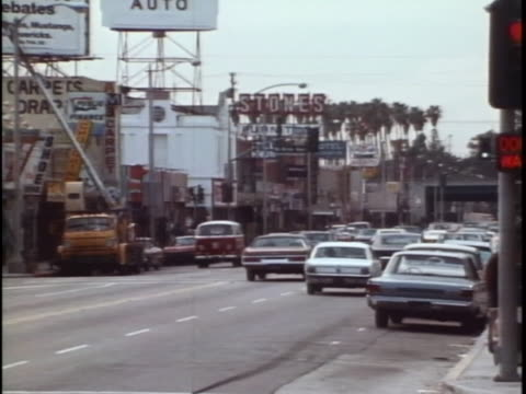 estabishing shot of a los angeles street with traffic in the 1970s. - pedestrian stock videos & royalty-free footage