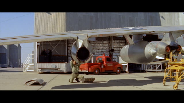 ms establish flight line at left wing of b 52 military jet bomber airplane - aereo militare video stock e b–roll