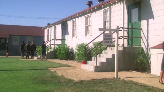 MS Establish one story barracks type building with sign 'visiting officer's quarters'.