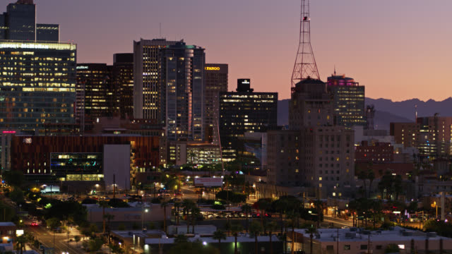 establishing aerial shot of downtown phoenix at twilight - arizona stock videos & royalty-free footage