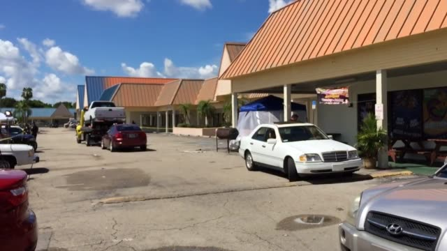 stockvideo's en b-roll-footage met establishing footage of the club scene with police footage of cars with broken glass and gunshot markings - fort myers