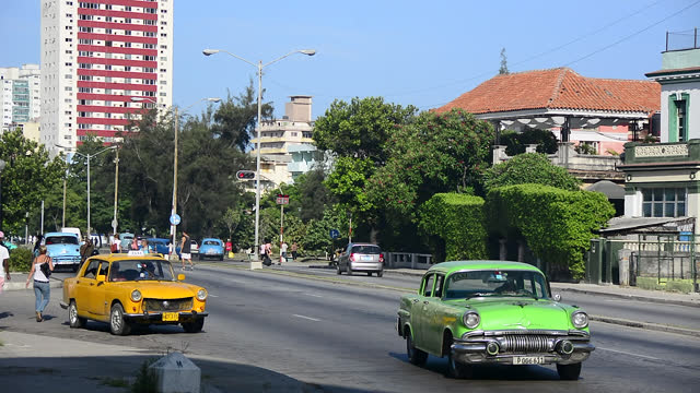 establishing shot and a sample of diverse traffic in the cuban capital city during the day on june 10, 2016; in havana city, havana, cuba. the image... - 1957 stock videos & royalty-free footage