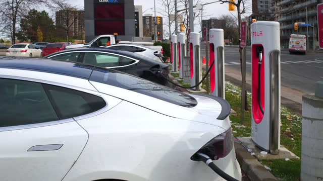 establishing shot at a tesla electric vehicles charging station outside of the don mills subway station seen on november 2, 2020; in toronto,... - electric vehicle stock videos & royalty-free footage