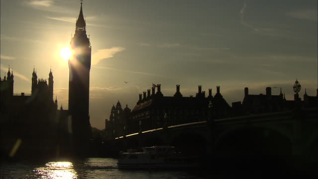 establishing shot, backlit and in silhouette of big ben clock tower in london, england - music or celebrities or fashion or film industry or film premiere or youth culture or novelty item or vacations stock videos & royalty-free footage