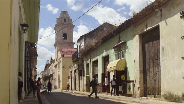 establishing shot including the santa clara convent with its distinctive bell tower on april 15 in old havana, havana, cuba. - convent stock videos & royalty-free footage