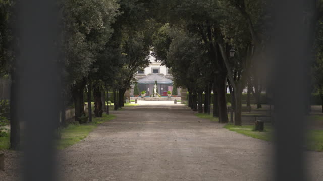 establishing shot looking in on the galleria borghese closed during the coronavirus pandemic in rome italy - healthcare and medicine or illness or food and drink or fitness or exercise or wellbeing video stock e b–roll