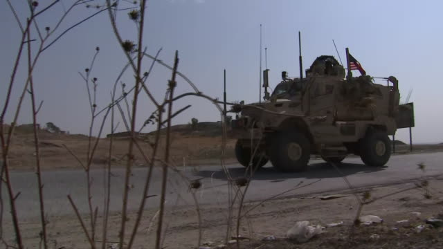 establishing shot of a convoy of u.s. military vehicles on the outskirts of dohuk in iraqi kurdistan. - united states and (politics or government) stock videos & royalty-free footage
