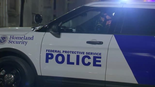 establishing shot of a federal protective service car parked outside the federal courthouse in portland, oregon. - crime or recreational drug or prison or legal trial stock videos & royalty-free footage