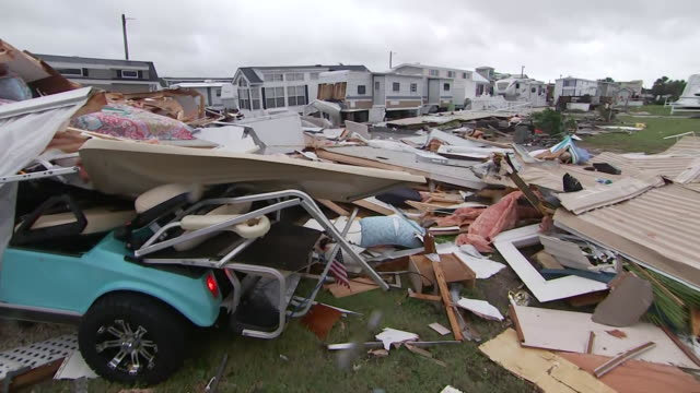 establishing shot of a golf cart covered in debris in the aftermath of hurricane dorian in emerald isle, north carolina. - 2010 2019 stock videos & royalty-free footage