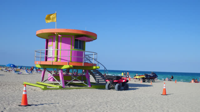 establishing shot of a lifeguard hut in miami beach on june 6 in miami, florida, usa. this tropical beach is a famous place and a major tourist... - copy space stock videos & royalty-free footage