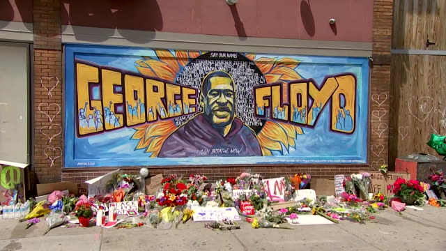 establishing shot of a memorial wall for george floyd near the location where he was killed in minneapolis, minnesota. - minnesota stock videos & royalty-free footage