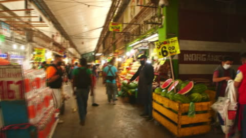 establishing shot of a mexico city food market during the coronavirus pandemic. - healthcare and medicine or illness or food and drink or fitness or exercise or wellbeing stock videos & royalty-free footage