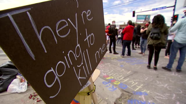 """establishing shot of a sign that reads """"they're going to kill me"""" during a protest at the location where george floyd was killed in minneapolis,... - minnesota stock videos & royalty-free footage"""
