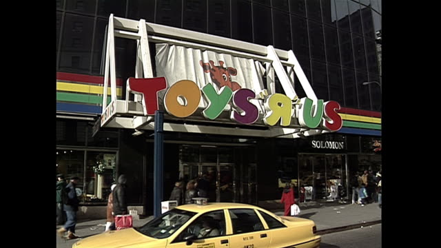 establishing shot of a toys r us retail store near herald square in new york city. - toys r us stock videos & royalty-free footage