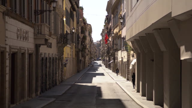establishing shot of an empty street in rome italy during the coronavirus pandemic - business or economy or employment and labor or financial market or finance or agriculture video stock e b–roll