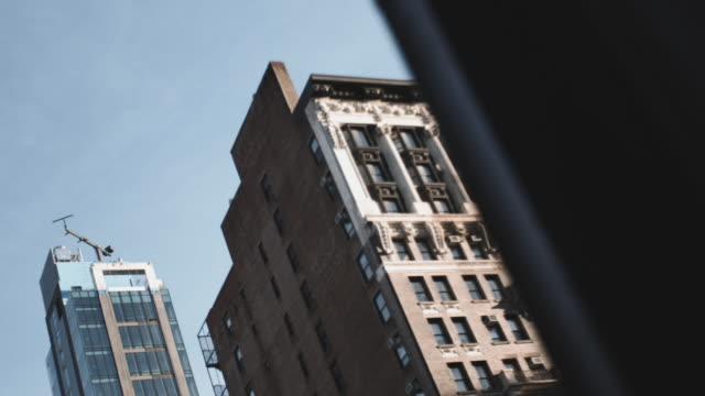 establishing shot of an unrecognizable apartment building in hell's kitchen, new york - hell's kitchen stock videos and b-roll footage