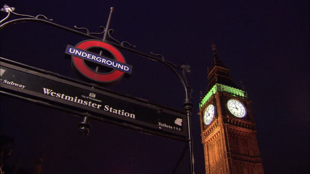establishing shot of big ben with the entrance sign for the westminster station underground station. - music or celebrities or fashion or film industry or film premiere or youth culture or novelty item or vacations stock videos & royalty-free footage