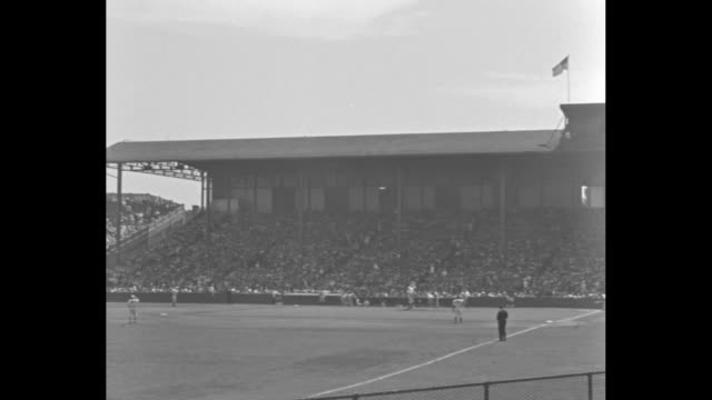Establishing shot of Braves Field during the AllStar Game / National League team standing in dugout together / Robert Lefty Grove and Jay Dizzy Dean...