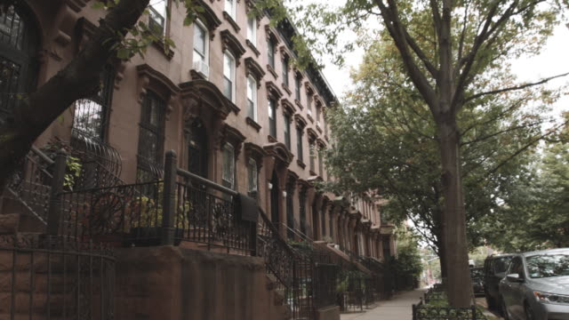 establishing shot of Brownstones in Fort Greene, Brooklyn on a cloudy afternoon - 4k
