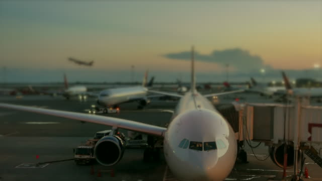 establishing shot of busy airport terminal. airplane transportation scenery - グランドキーパー点の映像素材/bロール