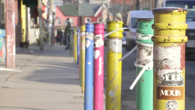 establishing shot of colored poles on sidewalk on a street kensington market. - music or celebrities or fashion or film industry or film premiere or youth culture or novelty item or vacations stock videos & royalty-free footage