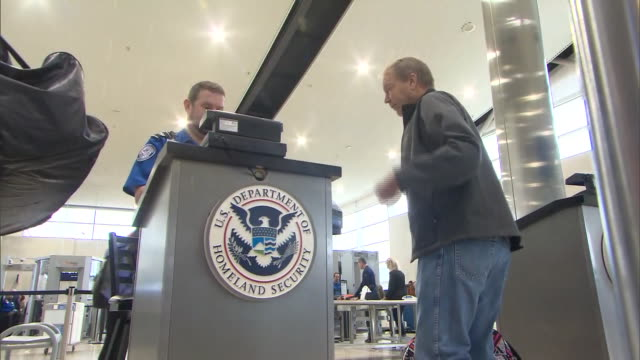 establishing shot of detroit metro airport travelers going through security check and getting tickets scanned at us department of homeland security... - department of homeland security stock videos & royalty-free footage