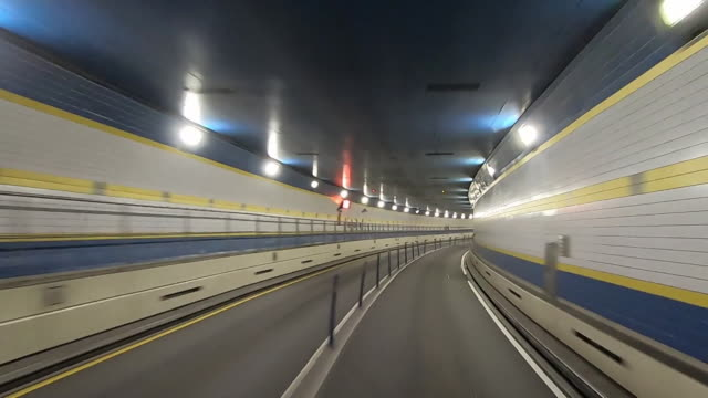 establishing shot of empty queens midtown tunnel in new york city. - epidemic stock videos & royalty-free footage