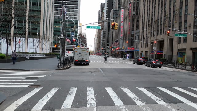 establishing shot of empty street at the intersection of 49th street and sixth avenue in new york city in front of radio city music hall and entrance... - radio city music hall stock videos & royalty-free footage
