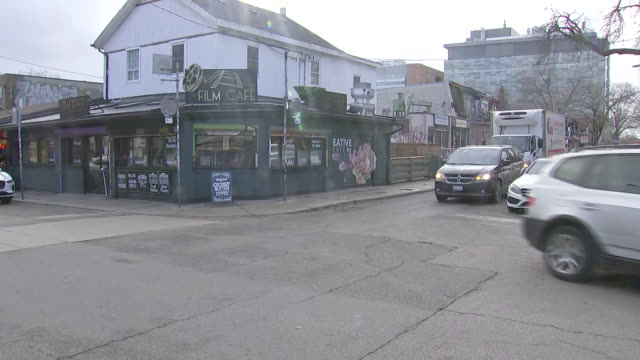 establishing shot of film cafe in kensington market. - music or celebrities or fashion or film industry or film premiere or youth culture or novelty item or vacations stock videos & royalty-free footage