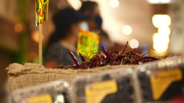 establishing shot of hot peppers at mexico city food market during the coronavirus pandemic. - healthcare and medicine or illness or food and drink or fitness or exercise or wellbeing stock videos & royalty-free footage